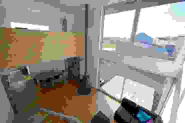 MD12-séjour et mezzanine Maisons modernes par Tektolab architectes Moderne