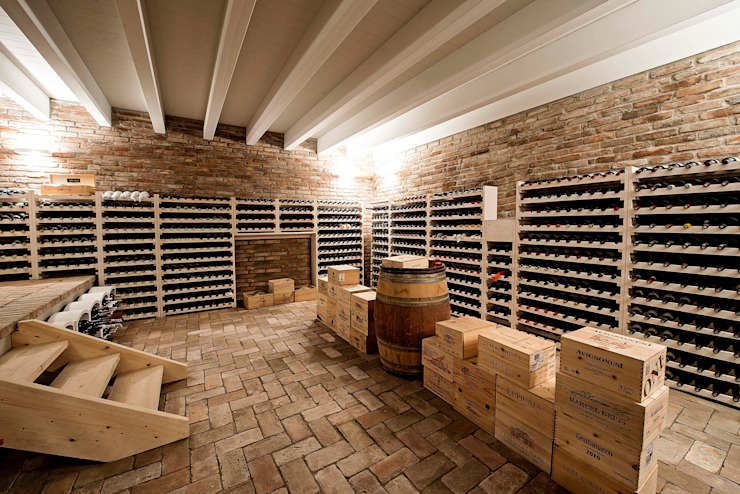 Country style wine cellar by Studio Tecnico Magenis Professionisti Associati Country