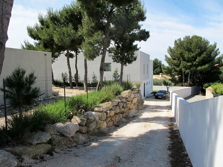 Casas de estilo minimalista de Christian Fares Minimalista