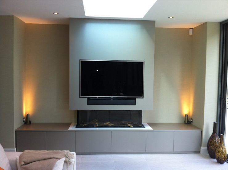 Flush fitting TV and cabinets Livings modernos: Ideas, imágenes y decoración de Designer Vision and Sound Moderno
