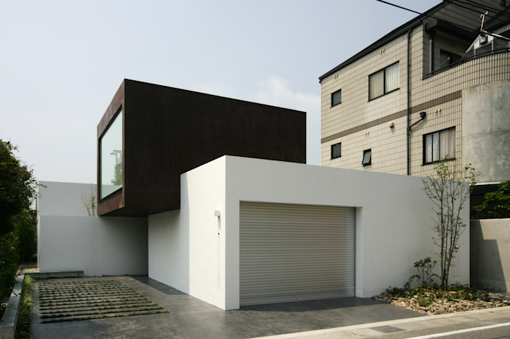 Minimalist house by 設計組織DNA Minimalist