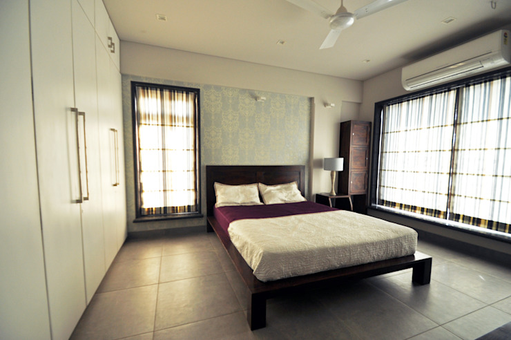RESIDENCE AT VILE PARLE (E) Modern style bedroom by Dhruva Samal & Associates Modern