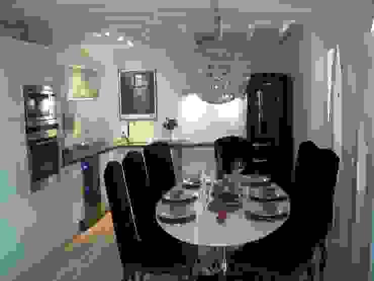 Féminiser un appartement un peu trop... masculin ! Cuisine moderne par espaces & déco Moderne