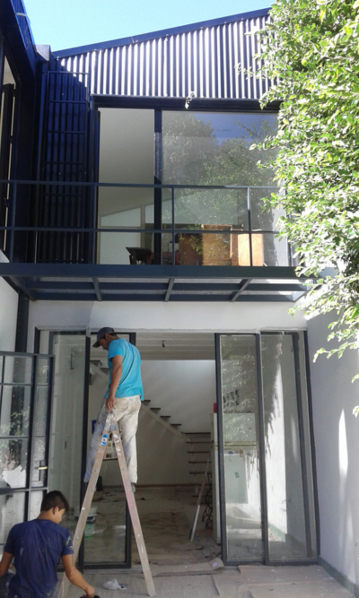 CASA FOTOMÁTICA Casas modernas: Ideas, imágenes y decoración de ESTUDIO MYGA Moderno