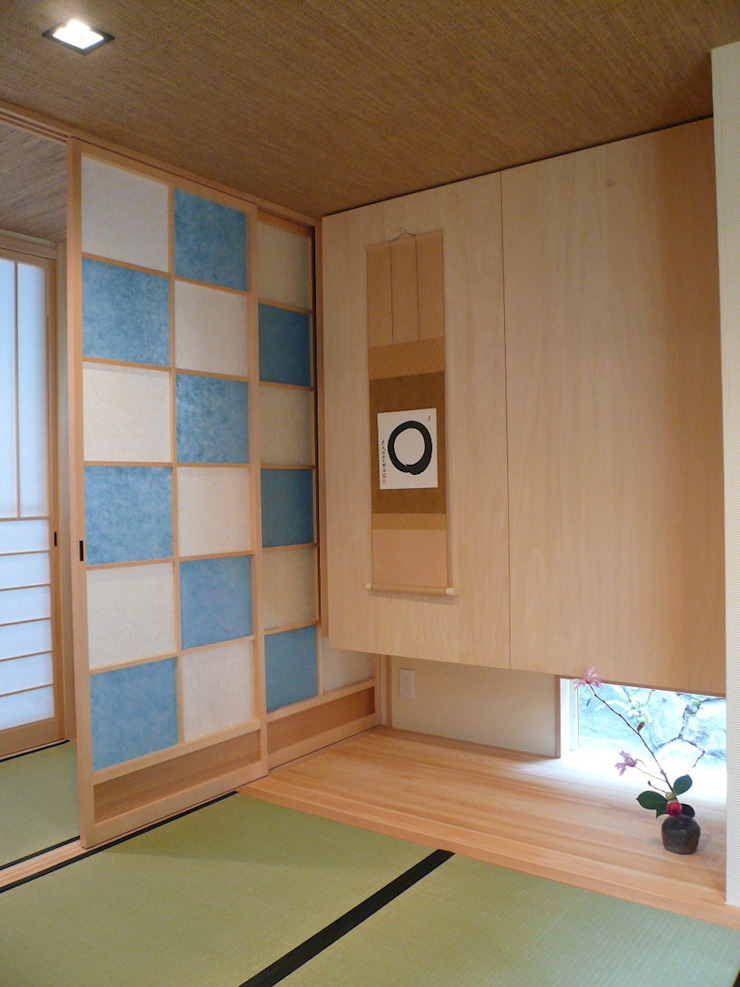 西川真悟建築設計 Pareti & Pavimenti in stile moderno