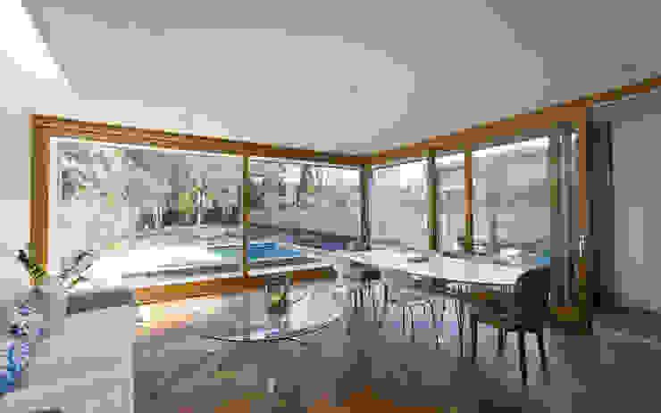 Kitchen with sliding oak doors Modern kitchen by Designcubed Modern