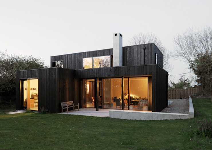 Casas de estilo  por Dow Jones Architects