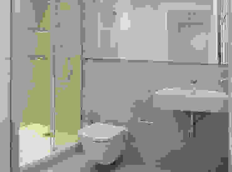 El microcemento como elemento unificador Baños de estilo moderno de Torres Estudio Arquitectura Interior Moderno