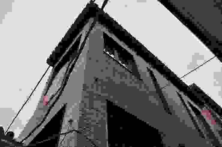 Fachada principal del bloque Casas de estilo clásico de ARQit estudio Clásico