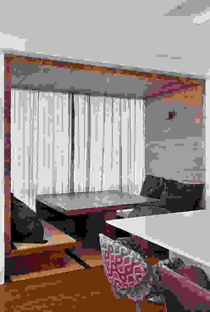 Salas de jantar rústicas por Cadore Arquitetura Rústico