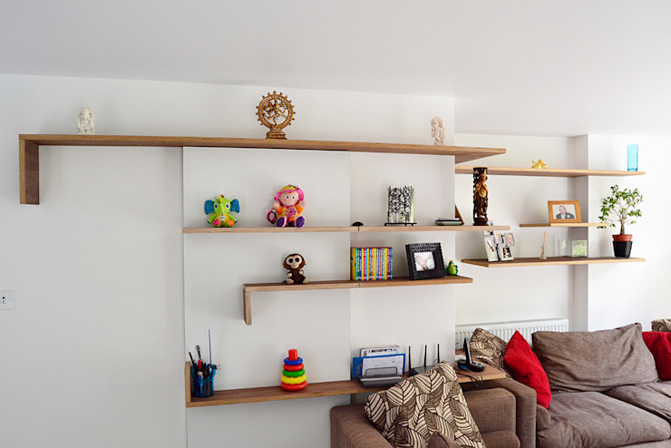 Walnut faced plywood shelves: modern  by Satish Jassal Architects, Modern