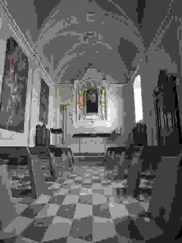 Restauro dell'Oratorio di San Luigi di PoliedroStudio srl Minimalista
