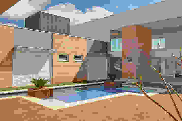 DORMITÓRIOS E PISCINA Piscinas modernas por VOLF arquitetura & design Moderno