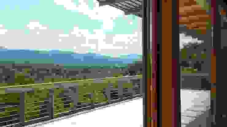 Terrazzo panoramico Balcone, Veranda & Terrazza in stile moderno di Team Replan - Bortoluzzi Associati Moderno