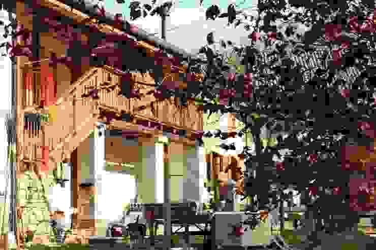 Prospetto Sud Case in stile rustico di Team Replan - Bortoluzzi Associati Rustico
