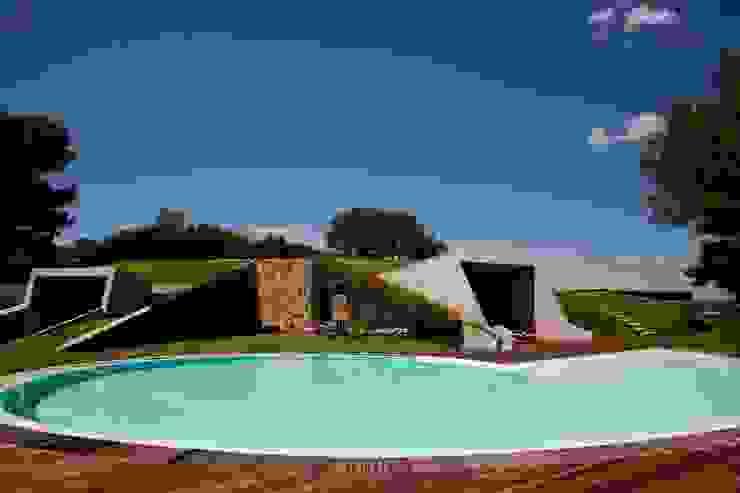 """Villa """"O"""" - Portisco, Sardegna Case in stile minimalista di Studio Marastoni Minimalista"""