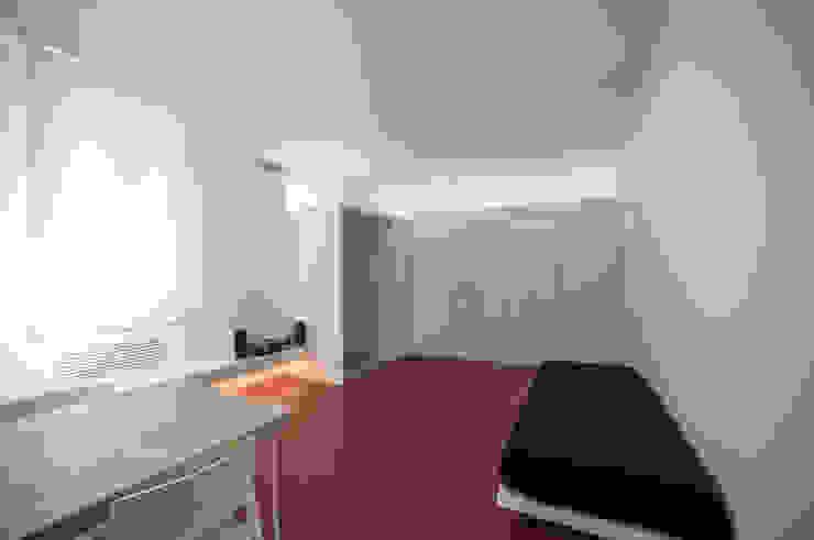 Casa per un fotografo Soggiorno minimalista di Silvia Bortolini architetto Minimalista
