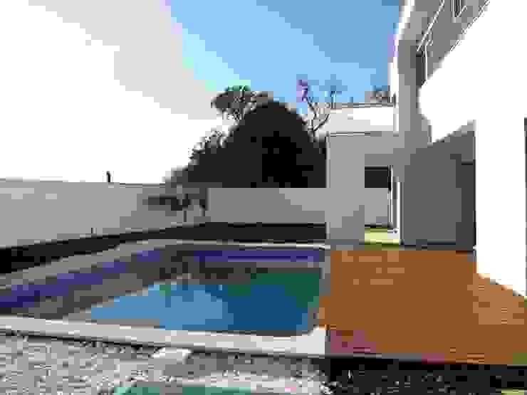 Moradia Unifamiliar em Loulé: Casas  por Ana Viegas