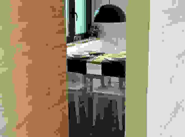 Cocina abierta al salón Cocinas de estilo moderno de davidMUSER building & design Moderno