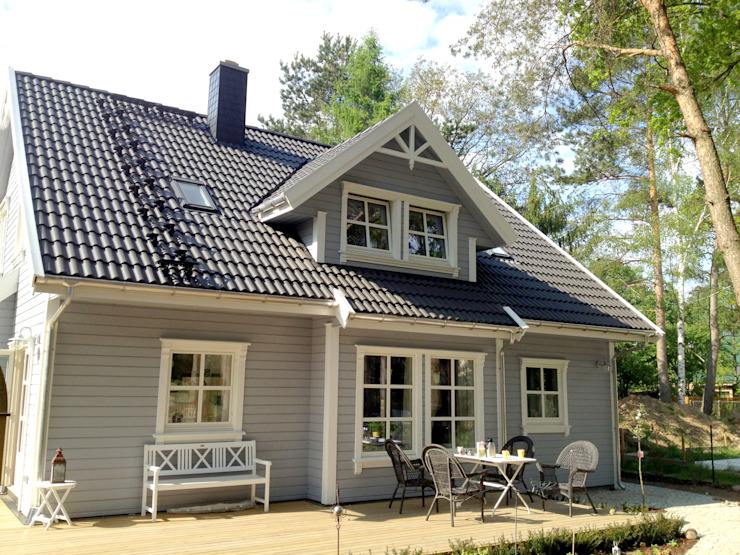 Casas de estilo escandinavo de Akost GmbH 'Ihr Traumhaus aus Norwegen' Escandinavo
