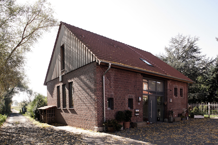 Country style houses by Lecke Architekten Country
