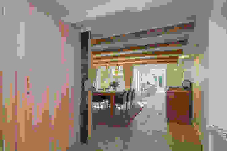 eetkamer en keuken aan de tuin Eclectische eetkamers van CUBE architecten Eclectisch
