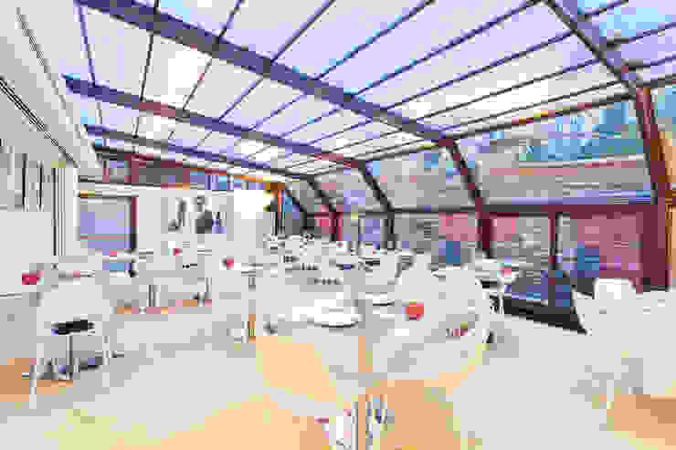 veranda Negozi & Locali commerciali in stile industrial di arcHITects srl Industrial