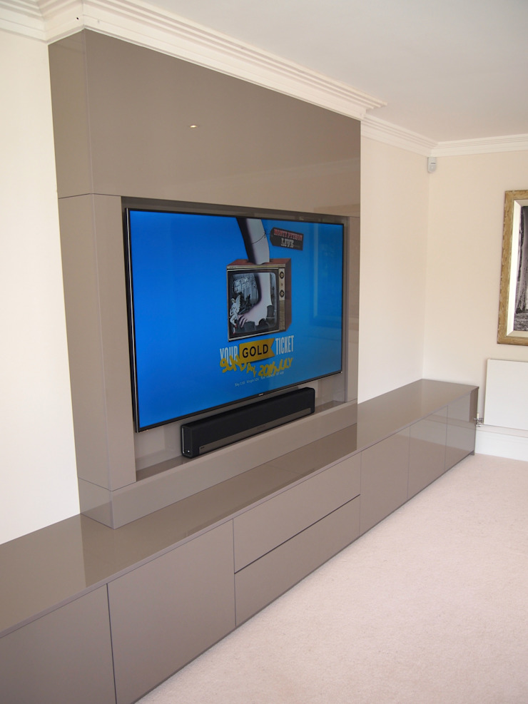 Modern stylish Media and storage unit, finished in high gloss pearl grey.: modern  by Designer Vision and Sound: Bespoke Cabinet Making, Modern