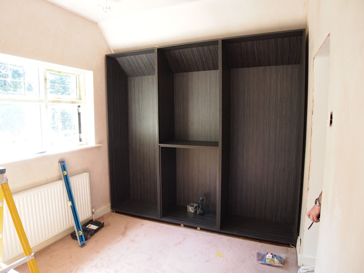 walk in his and her's wardrobes. before and after photos. Modern dressing room by Designer Vision and Sound: Bespoke Cabinet Making Modern