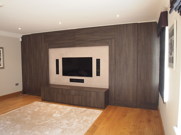 Dual purpose audio visual media unit with concealed 9 feet cinema screen and wood panelled walls. Designer Vision and Sound: Bespoke Cabinet Making Modern Media Room