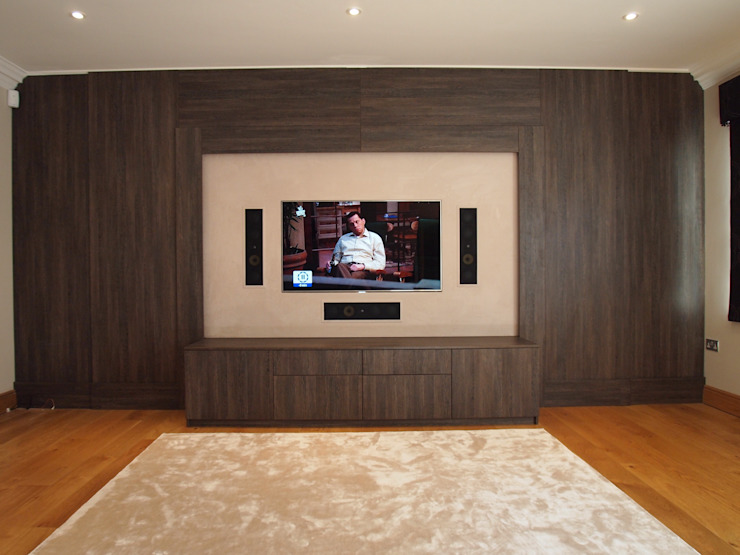 Dual purpose audio visual media unit with concealed 9 feet cinema screen and wood panelled walls. de Designer Vision and Sound: Bespoke Cabinet Making Moderno