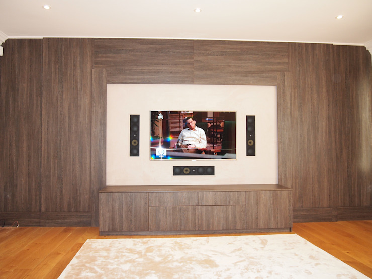 Dual purpose audio visual media unit with concealed 9 feet cinema screen and wood panelled walls. Modern living room by Designer Vision and Sound: Bespoke Cabinet Making Modern