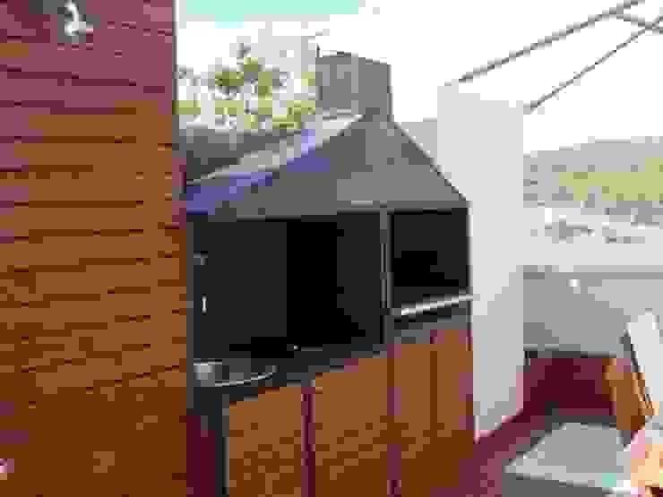 Proyectos y Mobiliario Jardines de estilo moderno de DEKMAK interiores Moderno