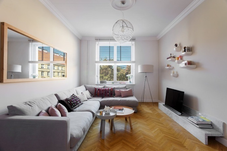 Small apartment in Warsaw Modern living room by Mięta Morris Modern