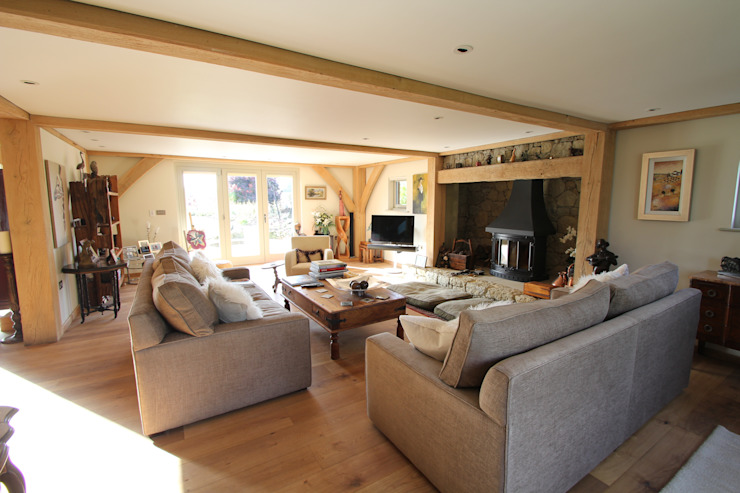 The main lounge and fireplace Country style living room by Hale Brown Architects Ltd Country