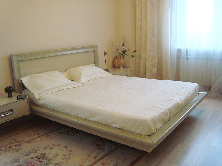 Светлая четырёхкомнатная квартира Спальня в эклектичном стиле от Дизайн В Стиле Эклектичный