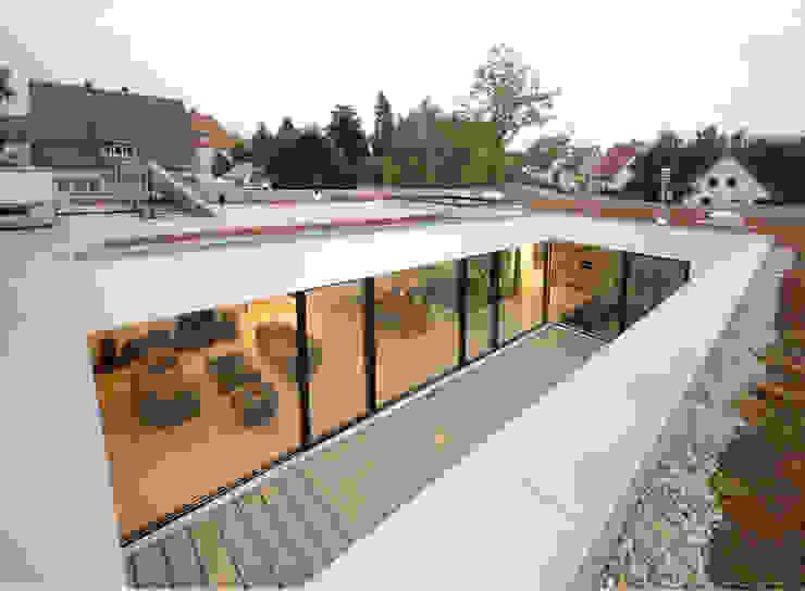 Houses by Osterwold°Schmidt EXP!ANDER Architekten, Modern