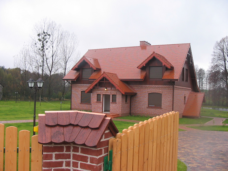 Country style houses by Piekarek Projekt-Paweł Piekarek Country
