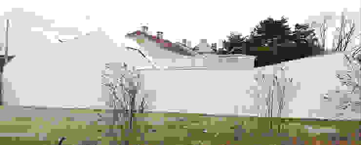 Eklektyczne domy od Caramel architekten Eklektyczny