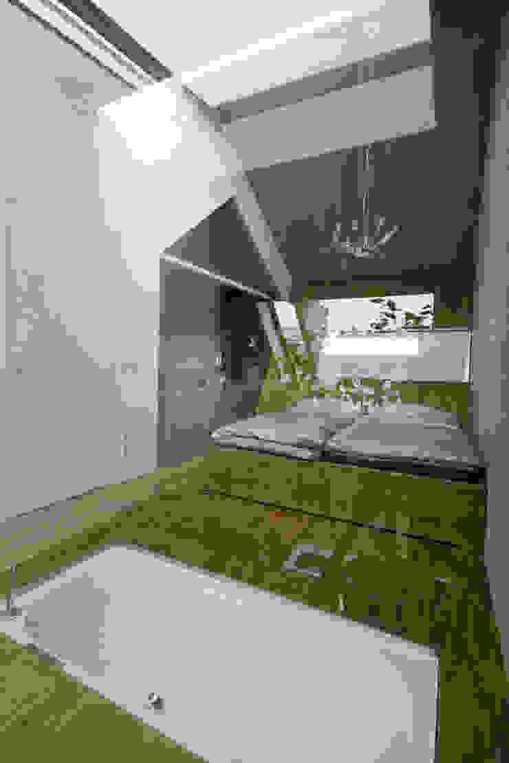 Caramel architekten Dormitorios de estilo ecléctico