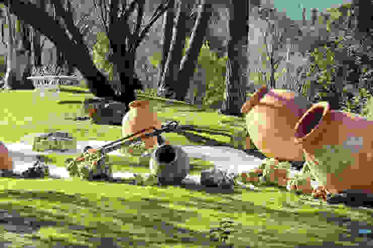 Jardines de estilo  por Bernadó Luxury Houses,