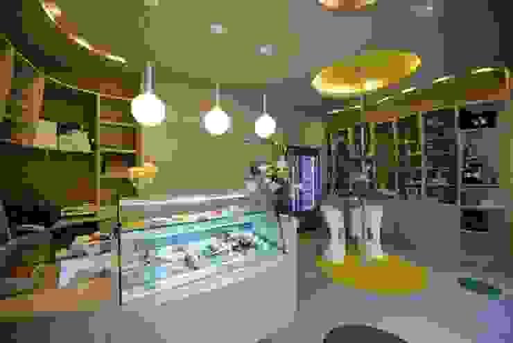 Artesanos del Almíbar Oficinas y tiendas de estilo moderno de Alicia Toledo Moderno
