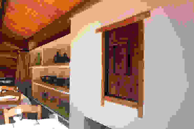 Vista de la planta superior Gastronomía de estilo rústico de ALBERT SALVIA dissenyador d'interiors Rústico