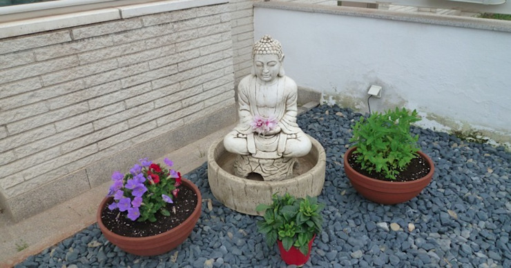 Asian style garden by Feng Shui Cristina Jové Asian