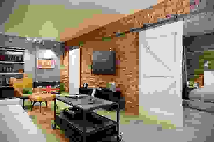 Salones de estilo industrial de CO:interior Industrial