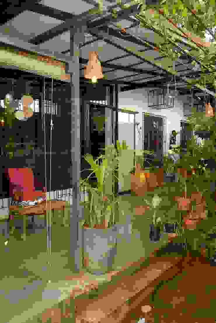 A house in Karjat The Orange Lane Rustic style balcony, veranda & terrace