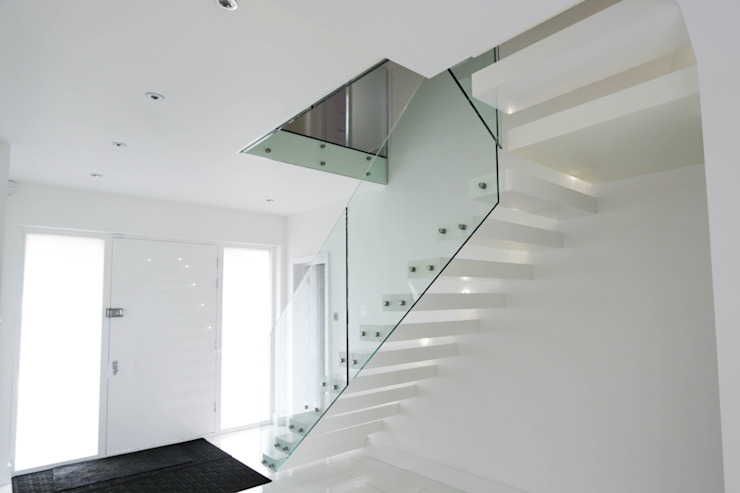 Cantilever Staircase realised in wood painted wait: modern  by Railing London Ltd, Modern