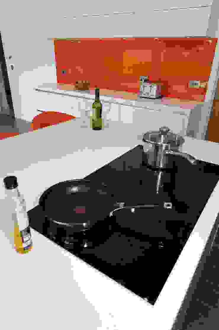 White & Orange Handless Modern kitchen by PTC Kitchens Modern