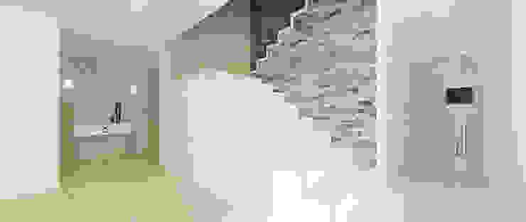 Widok na schody Minimalistyczny korytarz, przedpokój i schody od Ajot pracownia projektowa Minimalistyczny