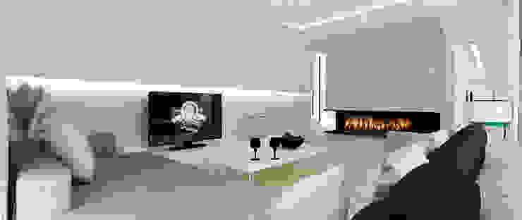 Salon - widok na kominek Minimalistyczny salon od Ajot pracownia projektowa Minimalistyczny
